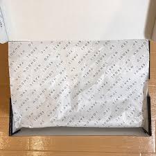 新品のNIKEのスニーカーを包んでいる包紙についての質問です。(画像は参考画像で